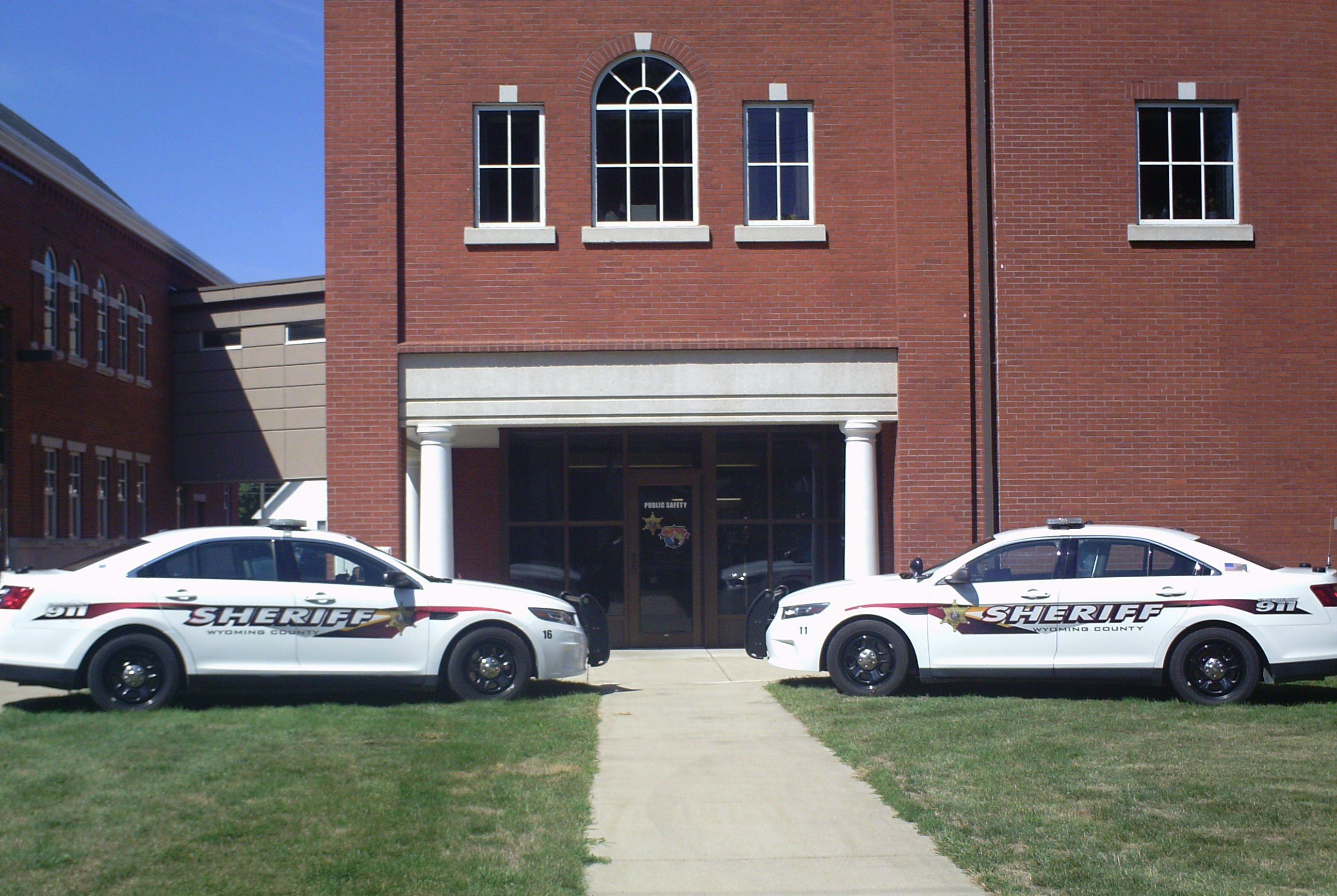 Patrol cars parked in front of brick building